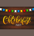 oktoberfest letterin on wooden background vector image