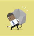 african businessman carrying a big rock vector image vector image
