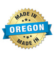 made in Oregon gold badge with blue ribbon vector image vector image