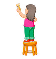 girl holding brush paint for painting vector image