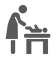 mother swaddle baby glyph icon parent vector image vector image