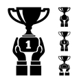 Hand holding trophy vector image vector image