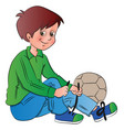 boy tying shoelace vector image vector image