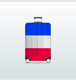 travel luggage bag with france flag vector image