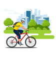 cyclist side view in a helmet on a city background vector image