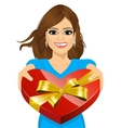 woman handing over a heart shaped box vector image vector image