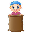 little boy playing jumping sack race vector image vector image