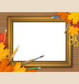 picture frame with autumn leaves and art supplies vector image vector image