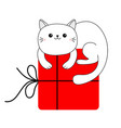 cute cat holding big red merry christmas gift box vector image