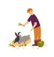 scene with a farmer feeding cute rabbits vector image