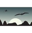 Silhouette of pterodactyl on sky scenery vector image