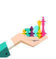 chess pieces in human hand business strategy vector image vector image