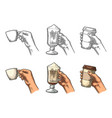 hands holding a cup coffee holder and glass of vector image vector image