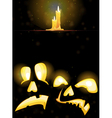 Horrible Jack o Lanterns and burning candles vector image vector image