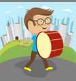 boy playing drum marching along the street vector image vector image