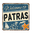 welcome to patras vintage rusty metal sign vector image vector image