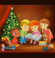 kids reading book beside a christmas tree vector image vector image