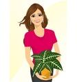 woman holding sanchezia plant vector image vector image