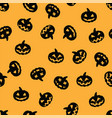 black halloween pumpkin pattern on orange vector image vector image