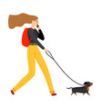 woman walking with dog vector image