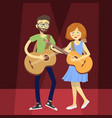 couple guitarist on red spotlight vector image