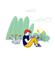 teenage boy sitting outdoors in garden reading vector image