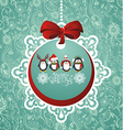 Christmas ball with penguins vector image vector image