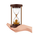 sand watches in hand time management concept vector image