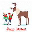 children feeding deer on winter holidays vector image