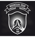 Travel label with mountain on blackboard vector image vector image