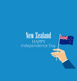 hand holds a new zealand flag independence day vector image vector image