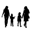 Silhouettes of young mothers with daughters