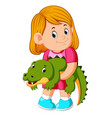 a little girl holding crocodille vector image