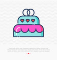 wedding cake with two rings on the top vector image vector image