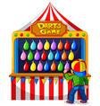 Boy playing darts game at carnival vector image