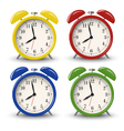 Yellow blue green red retro alarm clocks vector image vector image
