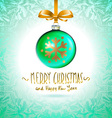 Christmas tree branch with green ball isolated