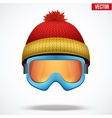 Knitted woolen red cap with snow goggles Winter vector image