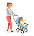 mother walks with son in blue bacarriage vector image