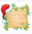 bamboo frame with santa hat vector image