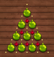 Christmas tree made of baubles on wooden vector image vector image