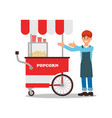 friendly seller standing near mobile popcorn cart vector image vector image