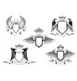 set heraldic winged shields vector image