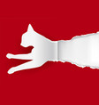 paper cat silhouette ripping paper vector image vector image