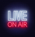 live on air neon glowing sign on a dark background vector image