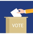 election hand holding ballot paper into box vector image vector image