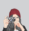 girl holding a film camera vector image vector image
