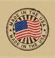 made in the usa stamp on cardboard background vector image vector image