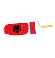 brush stroke with albania national flag isolated vector image vector image