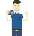 picture of asian man with a camera vector image vector image
